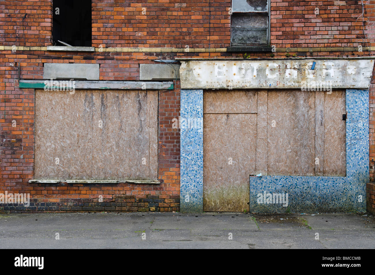 Abandoned shop with blocked up windows and doors in a street in Belfast & Abandoned shop with blocked up windows and doors in a street in ... Pezcame.Com