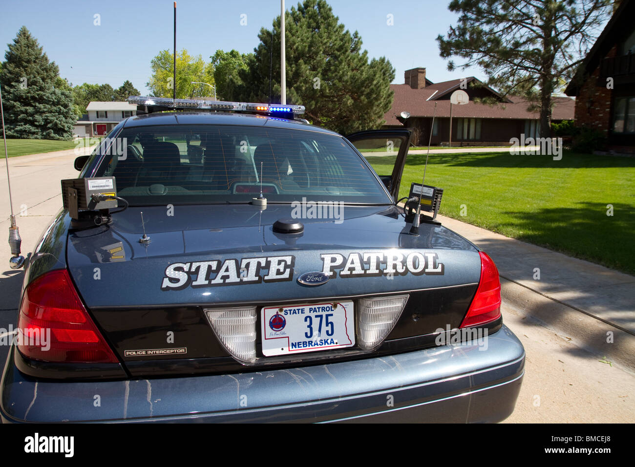 Automated license plate reader mounted on the trunk of a nebraska state patrol police interceptor ford