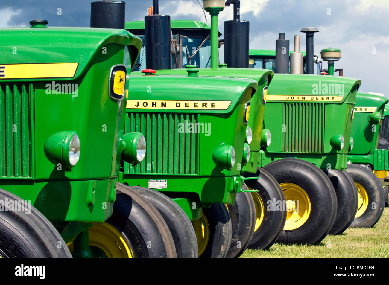 John Deere Line : John deere classic tractor line up stock photo royalty