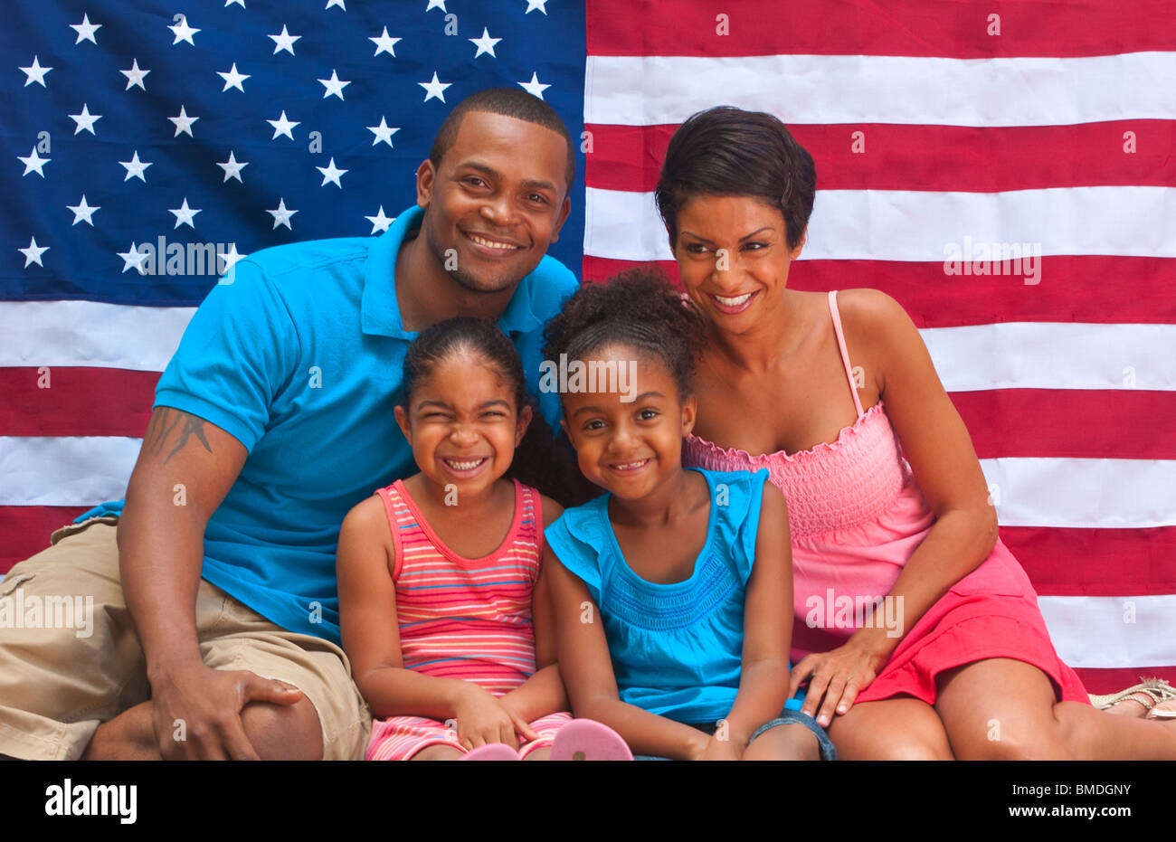 Black African American Family Loving The USA With Flag And Colors Of Holiday Celebration