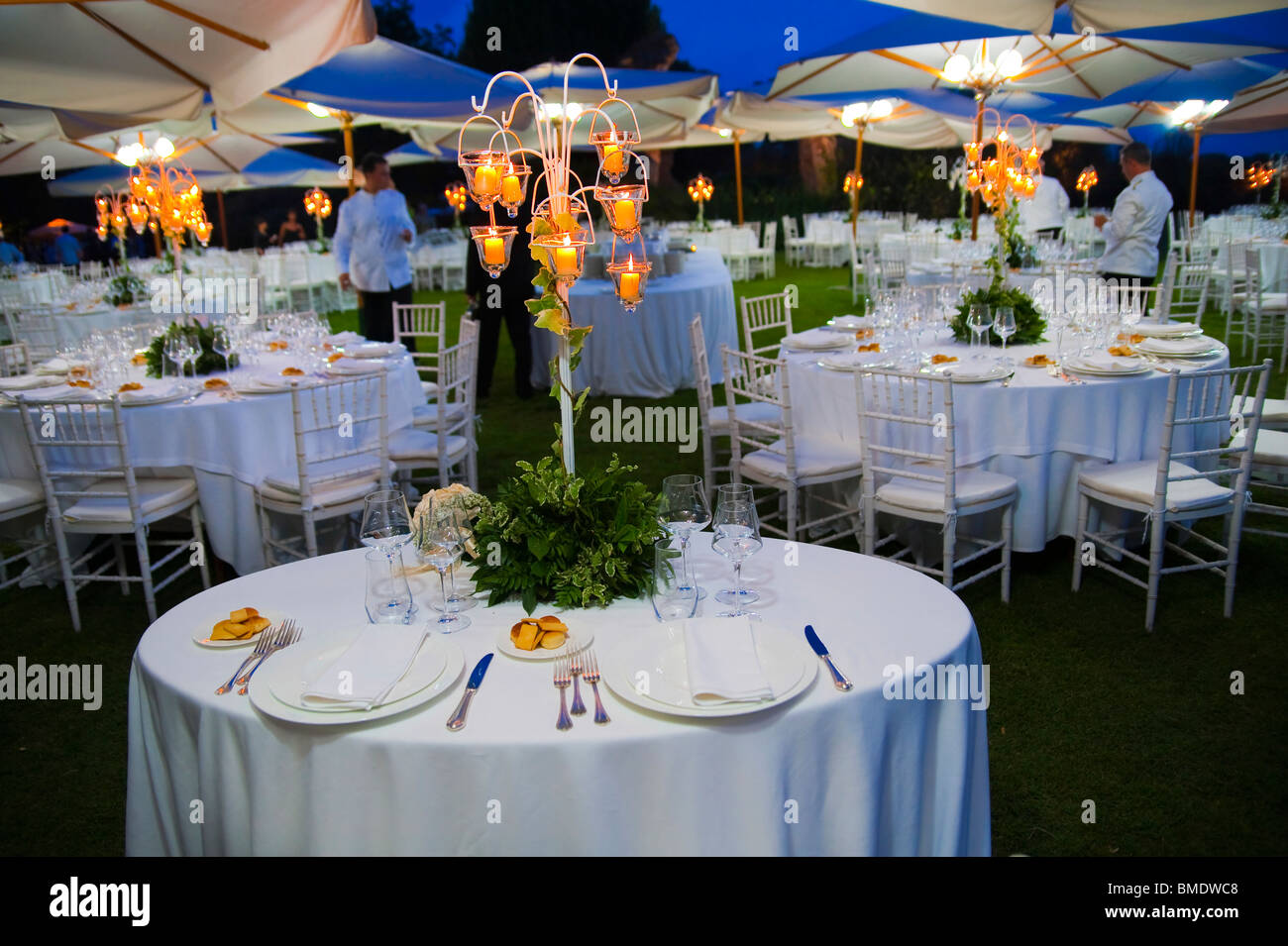 Outdoor wedding dinner table place setting at night stock Outdoor dinner table setting