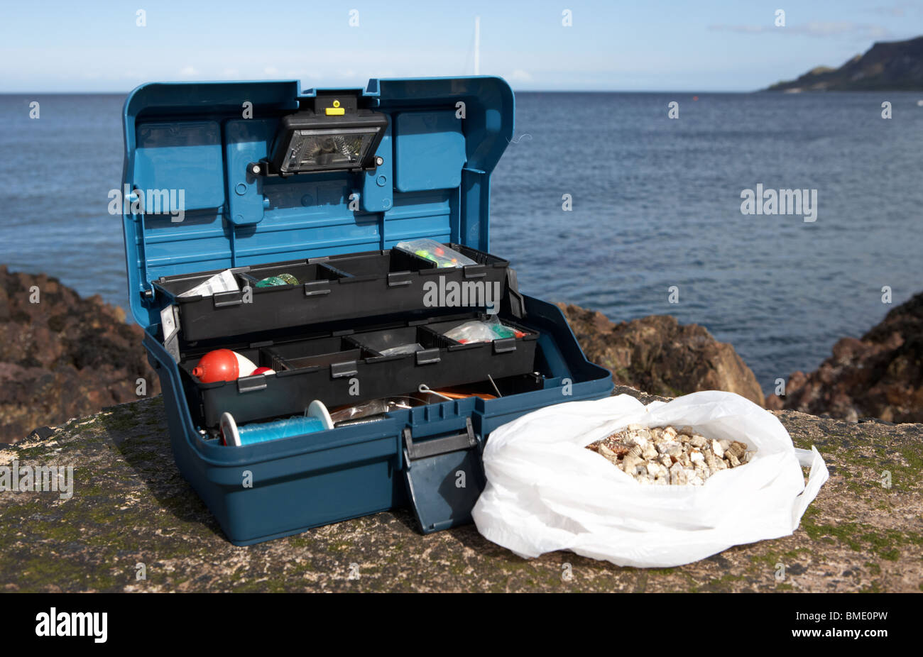 fishing tackle box filled with sea fishing gear and bag of ragworm, Fishing Rod