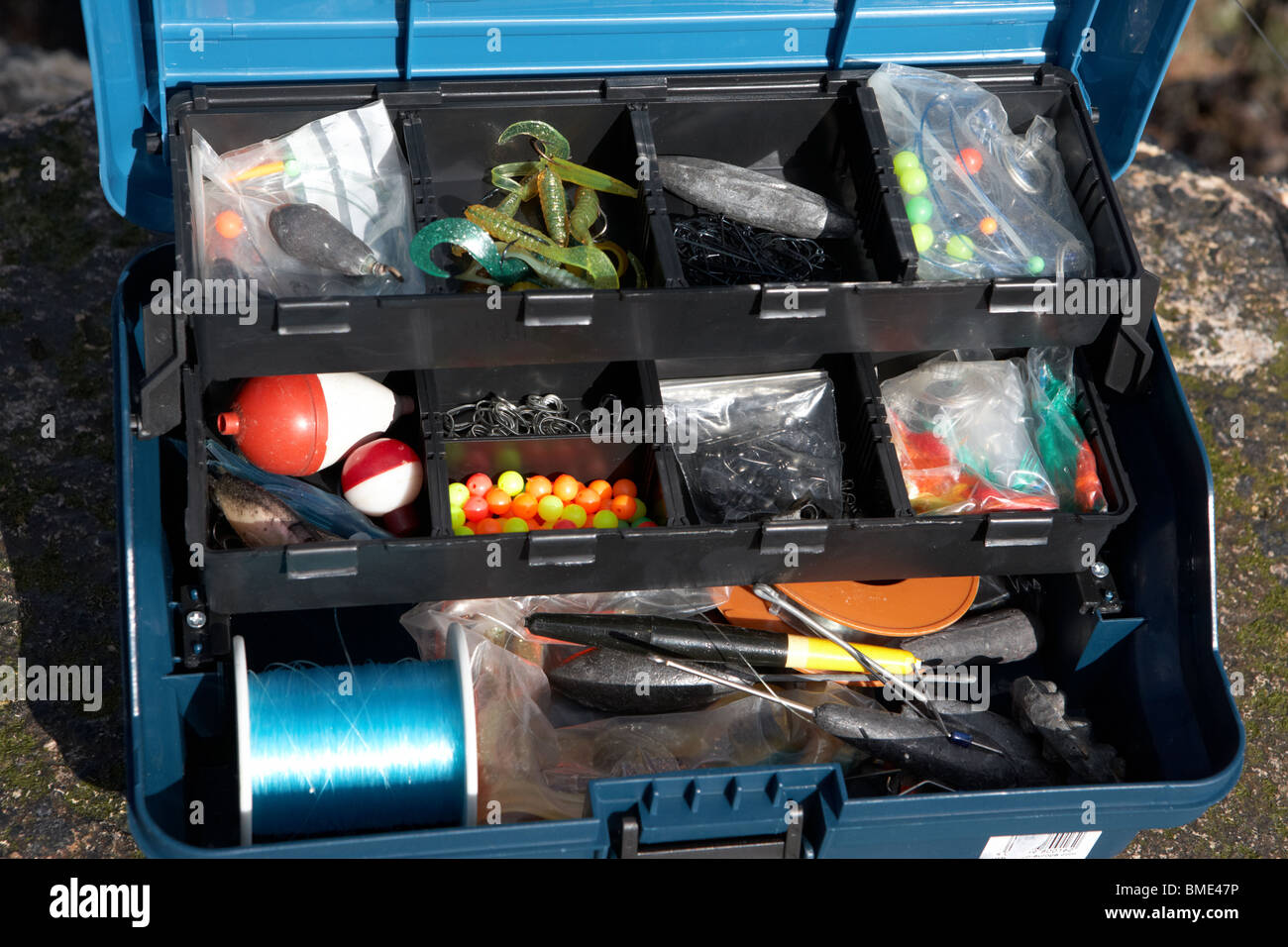 Fishing tackle box filled with sea fishing gear northern for Ocean fishing gear