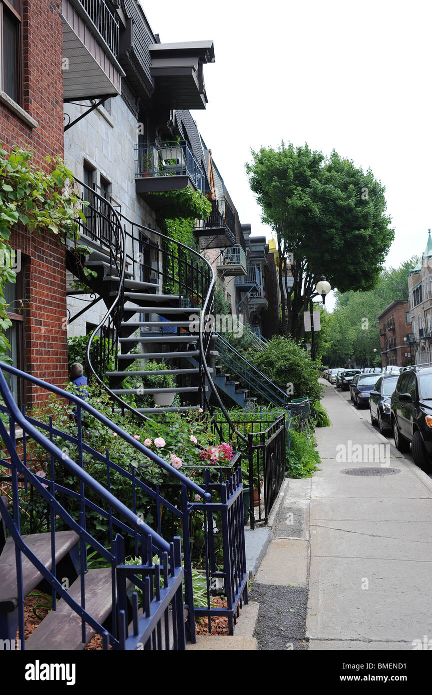 Houses With Outside Spiral Staircases Along A Road In Residential Stock Photo