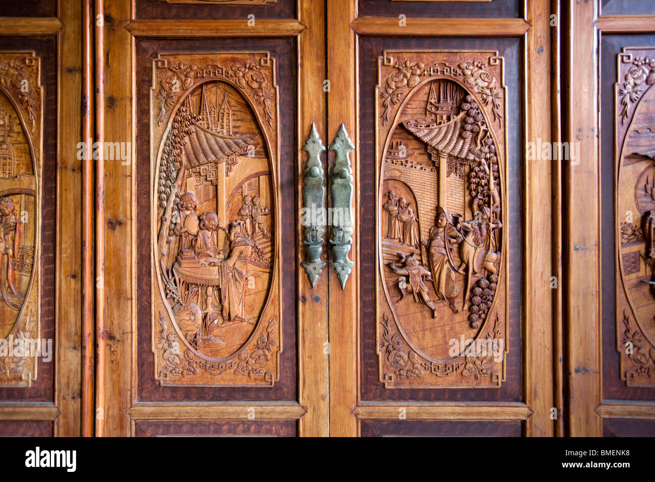 Detail Of Wooden Closet Door Carved With Ancient Stories