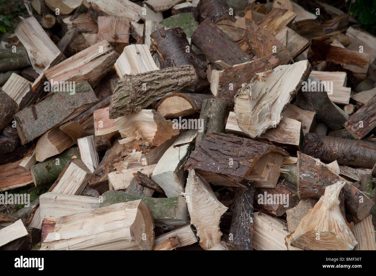 Log Pile In The Garden Hampshire England Stock Photo