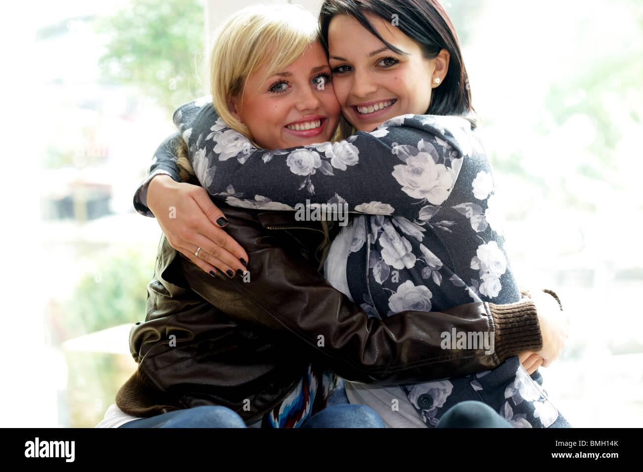 Teenage Girlfriends Hugging. Model Released Stock Photo ...