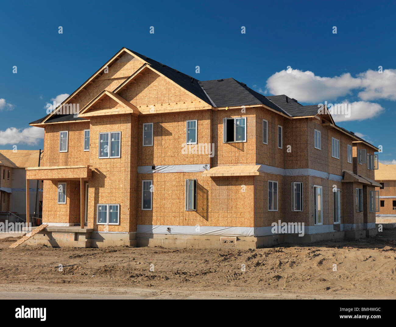 Wooden frame two story house with osb sheathed walls under for Building a house in ontario