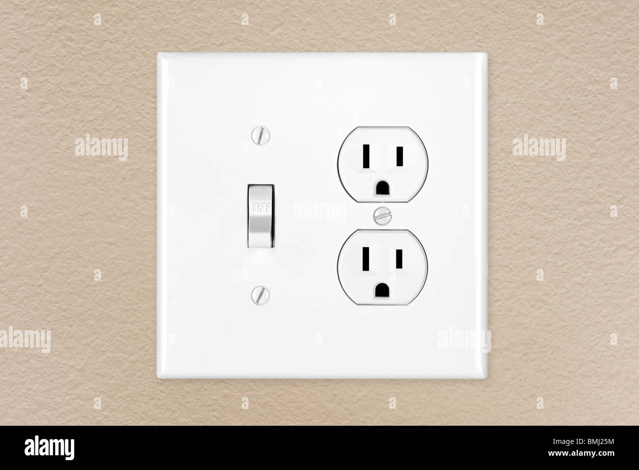 A Brand New Modern Electrical Toggle Light Switch And Power Outlet On Freshly Painted Wall