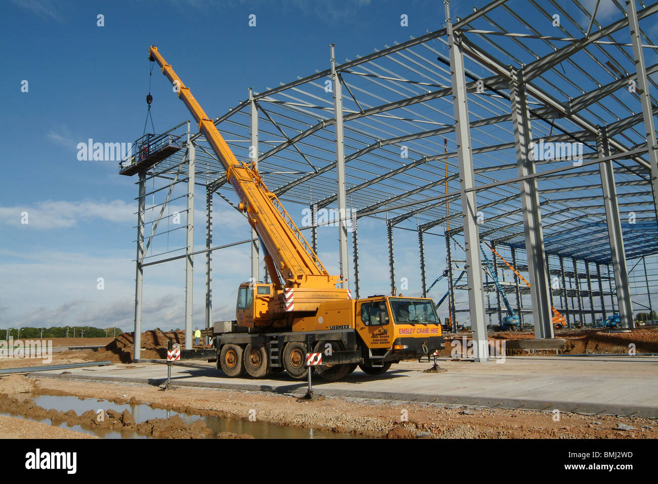huge mobile crane working on a building site in england stock photo royalty free image. Black Bedroom Furniture Sets. Home Design Ideas