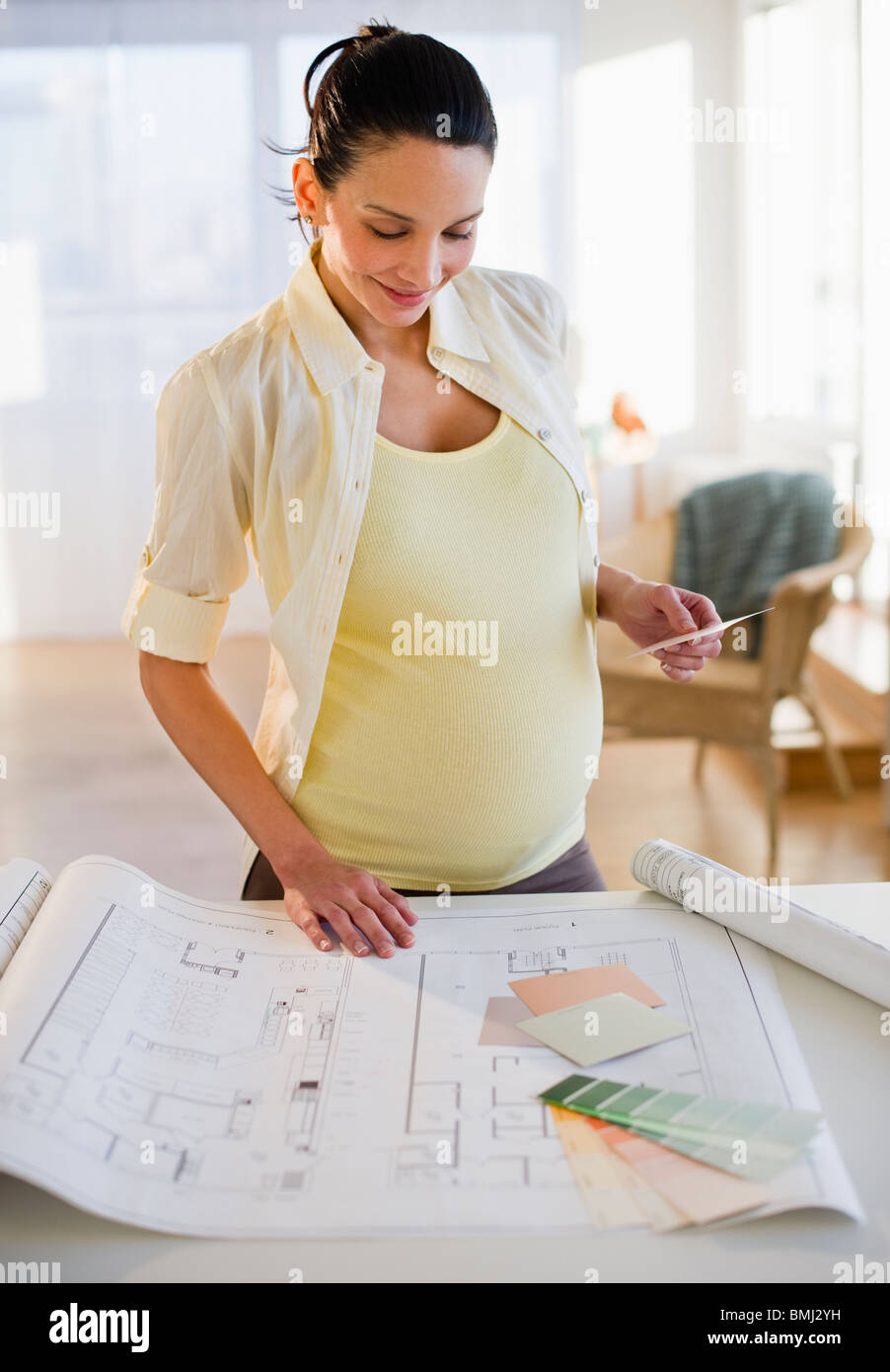 Pregnant Woman Looking t House Plans Stock Photo, oyalty Free ... - ^