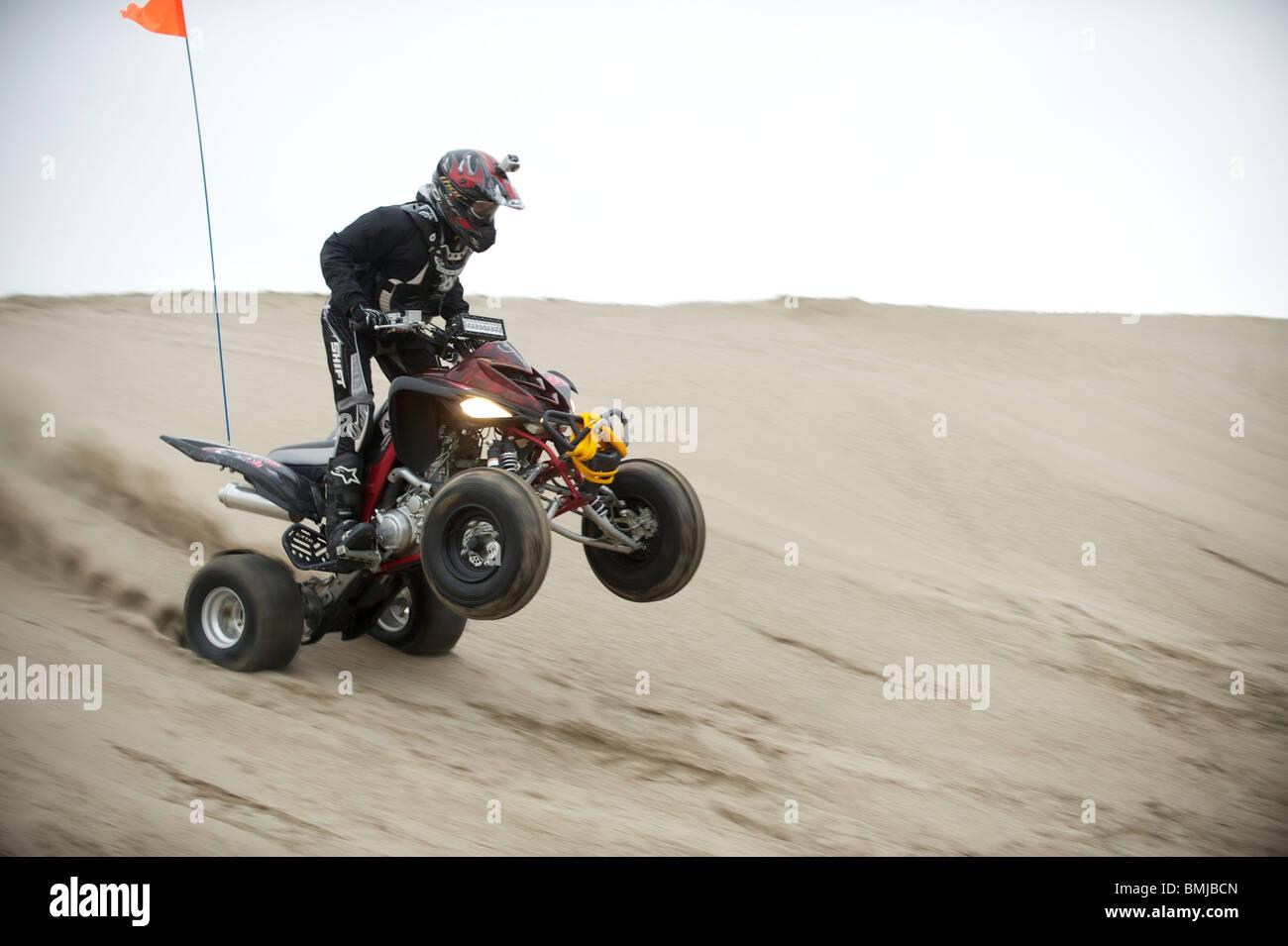 Dune Buggies Quad Bikes Atcs And Dirt Bikes Ride Through Sand