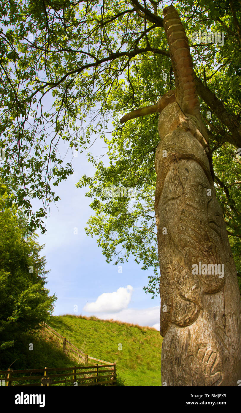 Old Tree Stump Carved Into A Totem Pole In Visitor Car Park At
