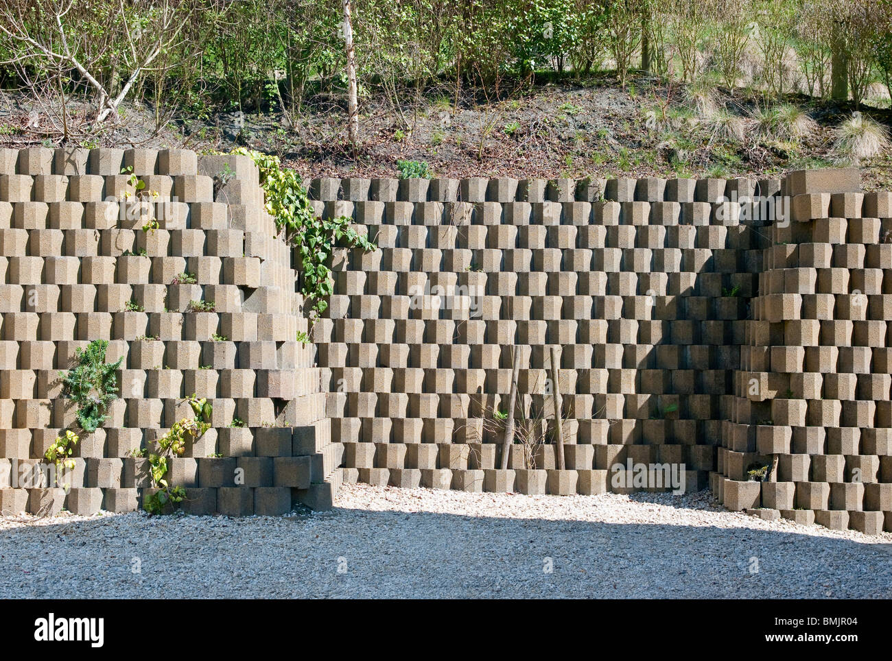 Neat Concrete Block Retaining Wall At Bottom Of Hill Side Garden