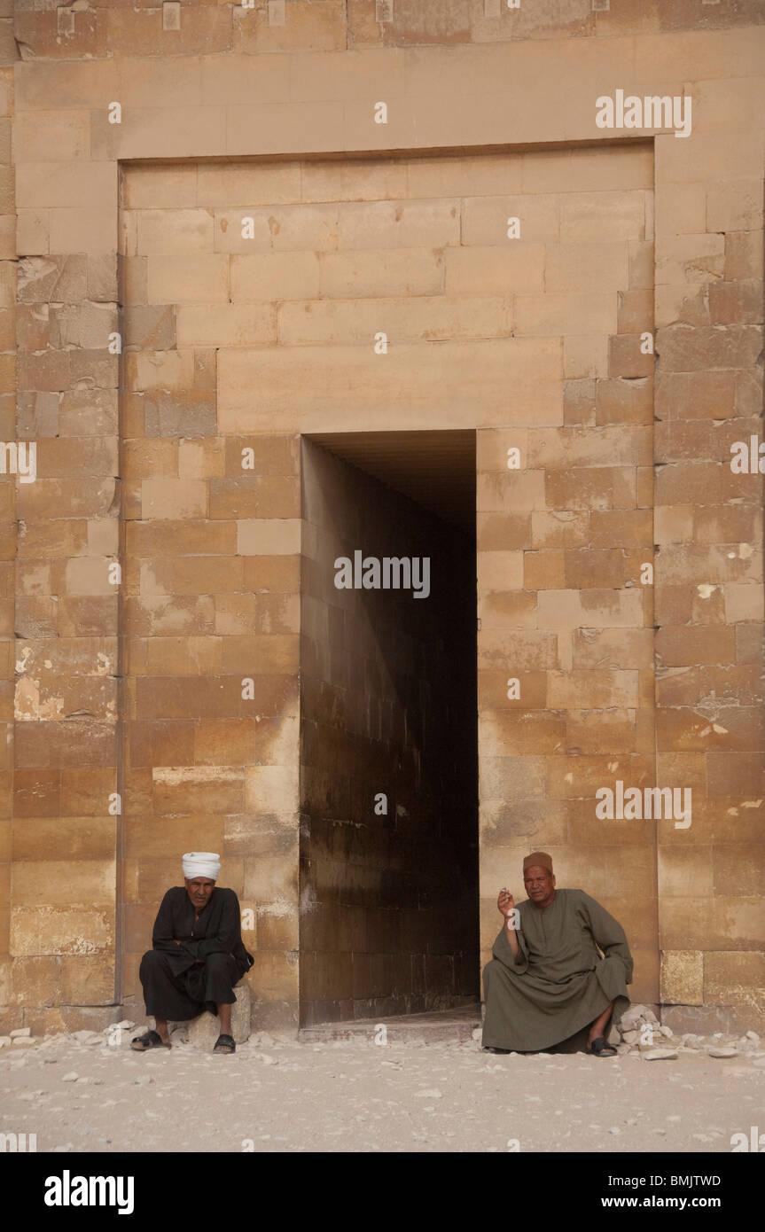 Egypt, Saqqara. Mortuary Complex outside the pyramid of Unas. Men in ...