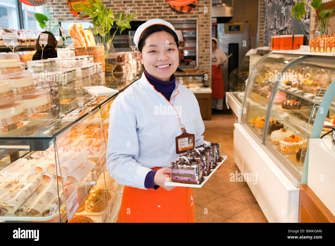 young shop worker in bakery shanghai stock photo royalty stock photo young shop worker in bakery shanghai