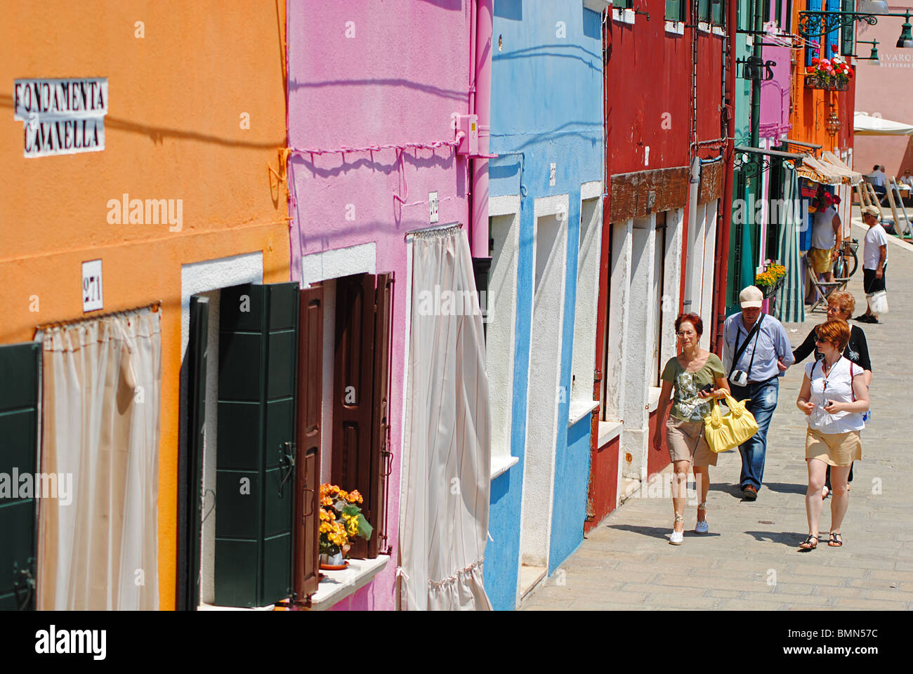 Colorful burano italy burano tourism - Stock Photo Tourists Walk Down A Colorful Street On The Island Of Burano Italy