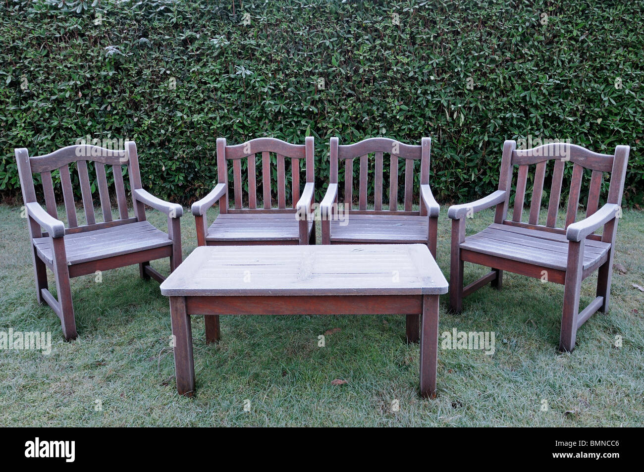 ice frost covered garden furniture wooden seat bench winter cold hedge seat chairs table seating - Garden Furniture Table Bench Seat