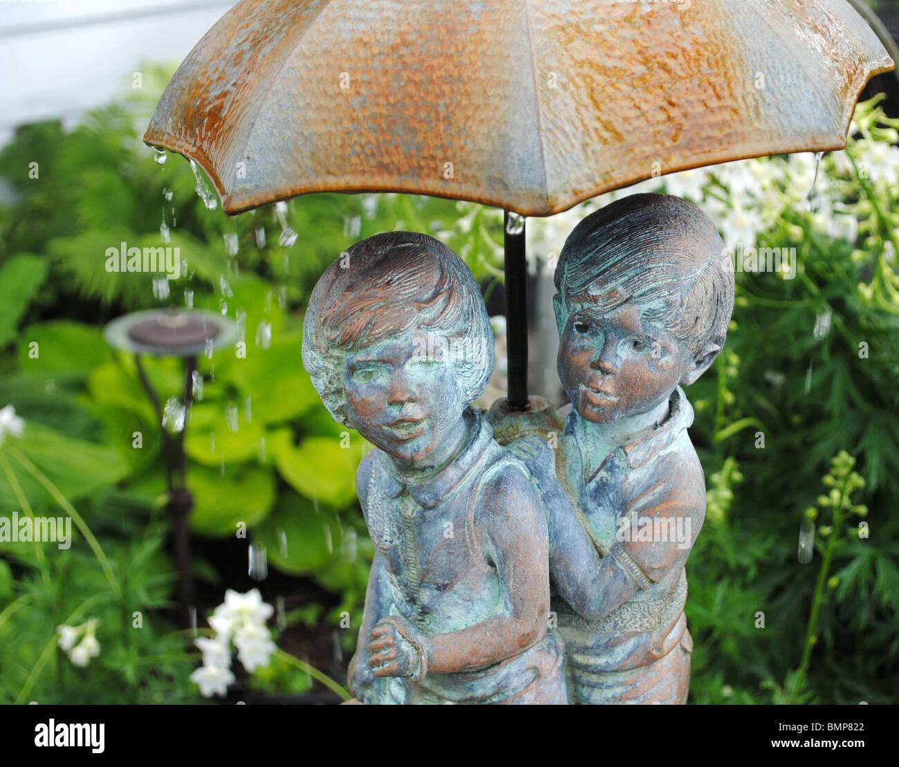 Garden Water Fountain Boy And Girl Under Umbrella Stock