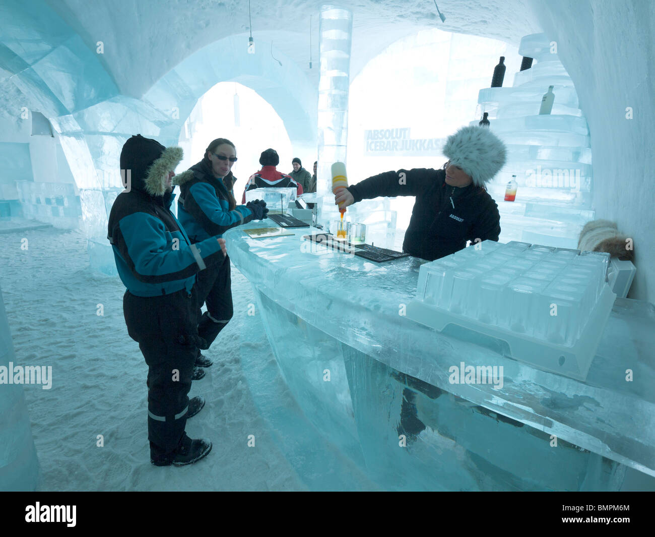 tourists stand in the absolut icebar in the jukkasj rvi icehotel stock photo royalty free image. Black Bedroom Furniture Sets. Home Design Ideas