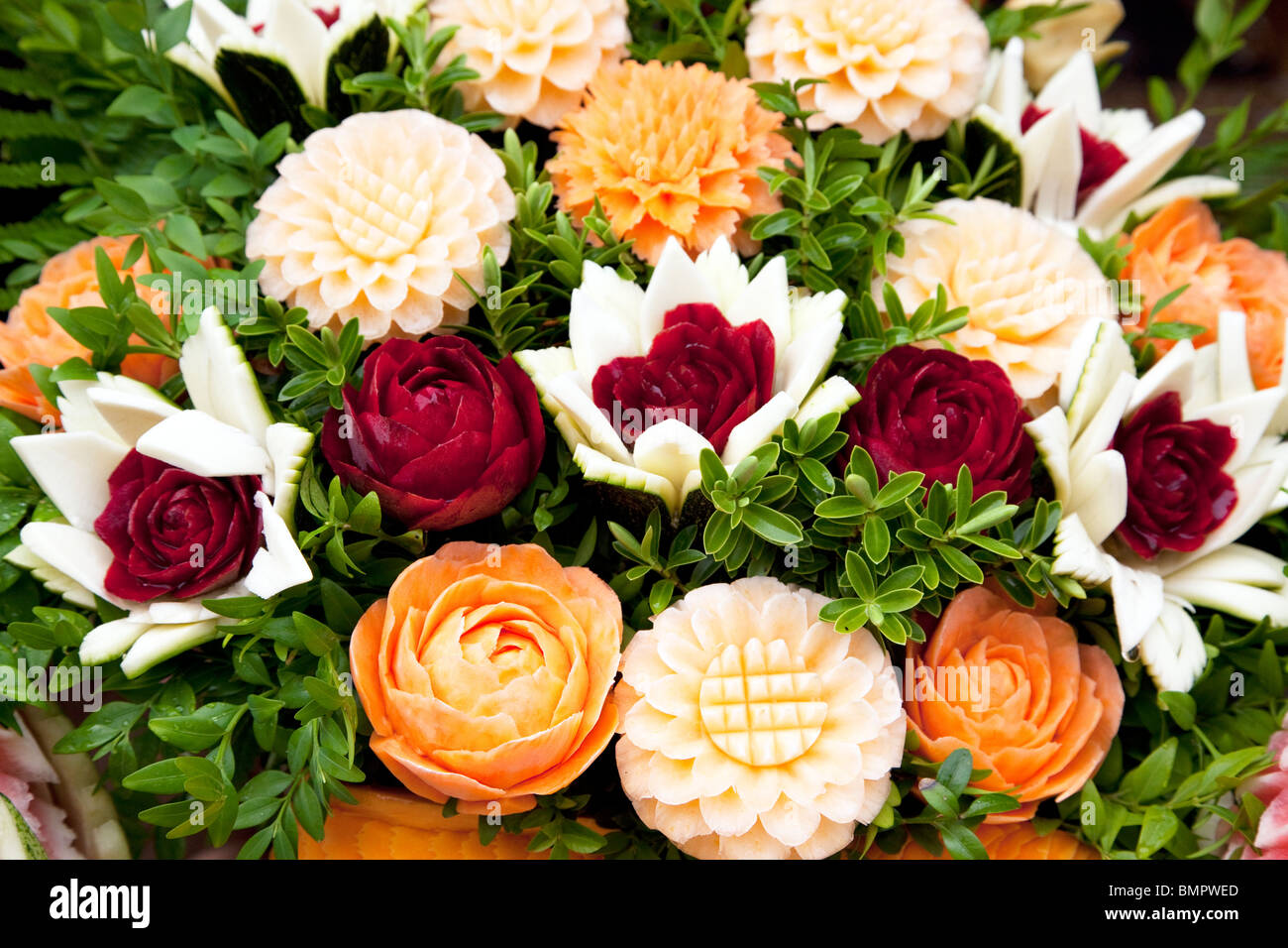 Flowers carved from fruit vegetables at thai festival