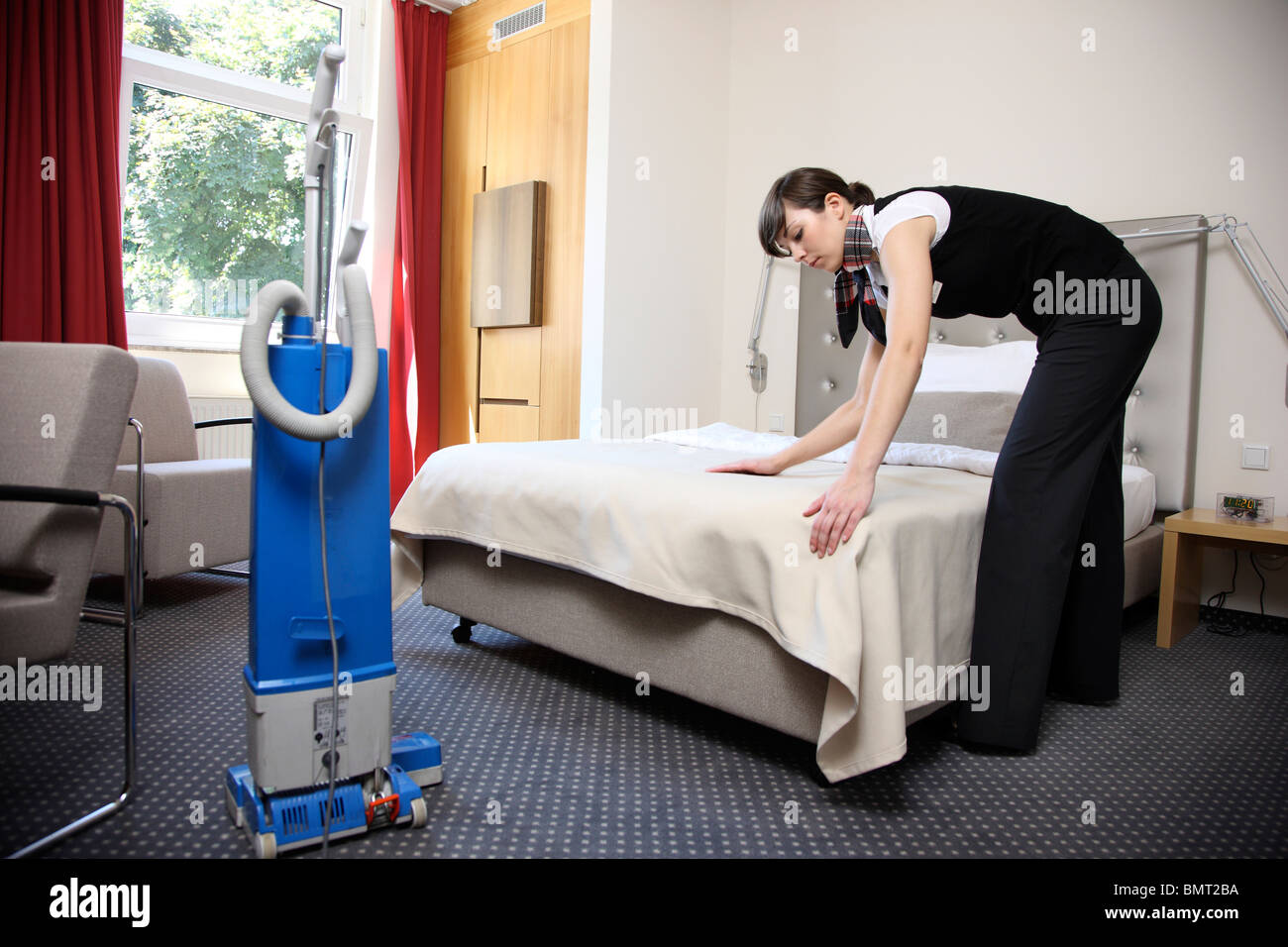 Hotel room service house keeping at work in a hotel room for How to clean a small bedroom
