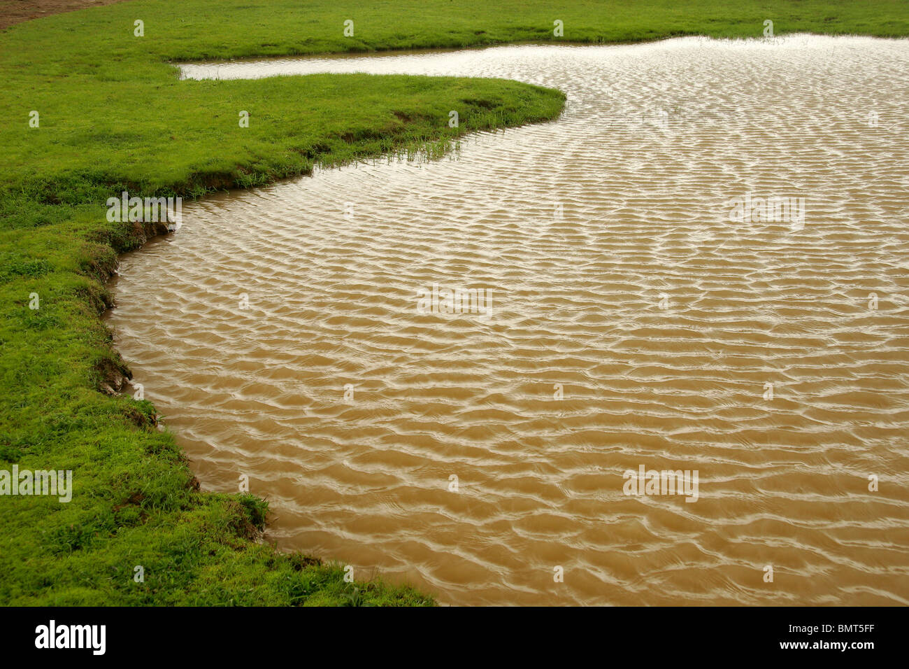 Panchgani photos around panchgani images panchgani temple photos - Abstract In Form Of Natural Pond With Thick Ripples Fresh Green Grass All Around Table Land