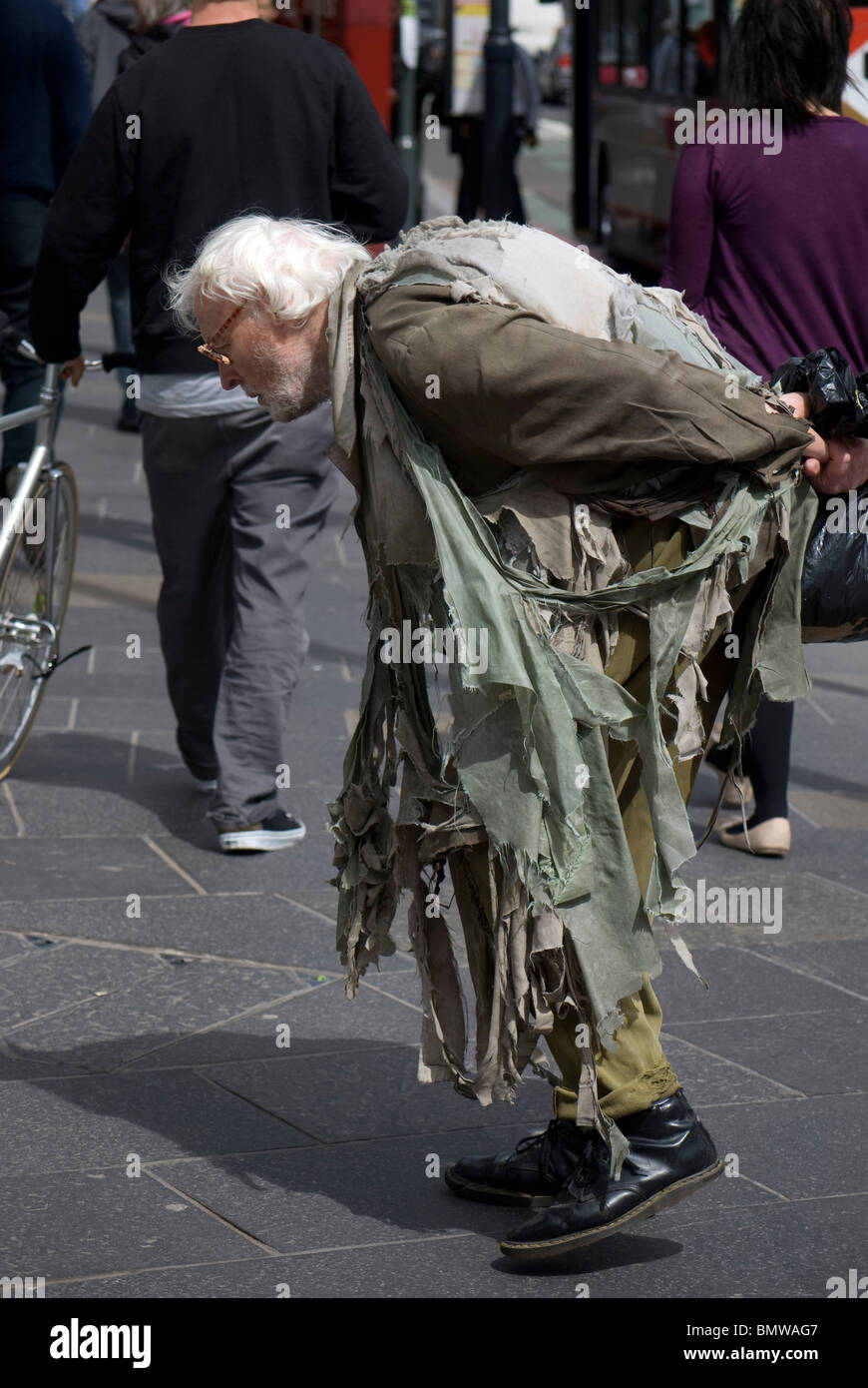 Down-and-out tramp/hobo wearing very ragged clothing in ...  Ragged Clothes