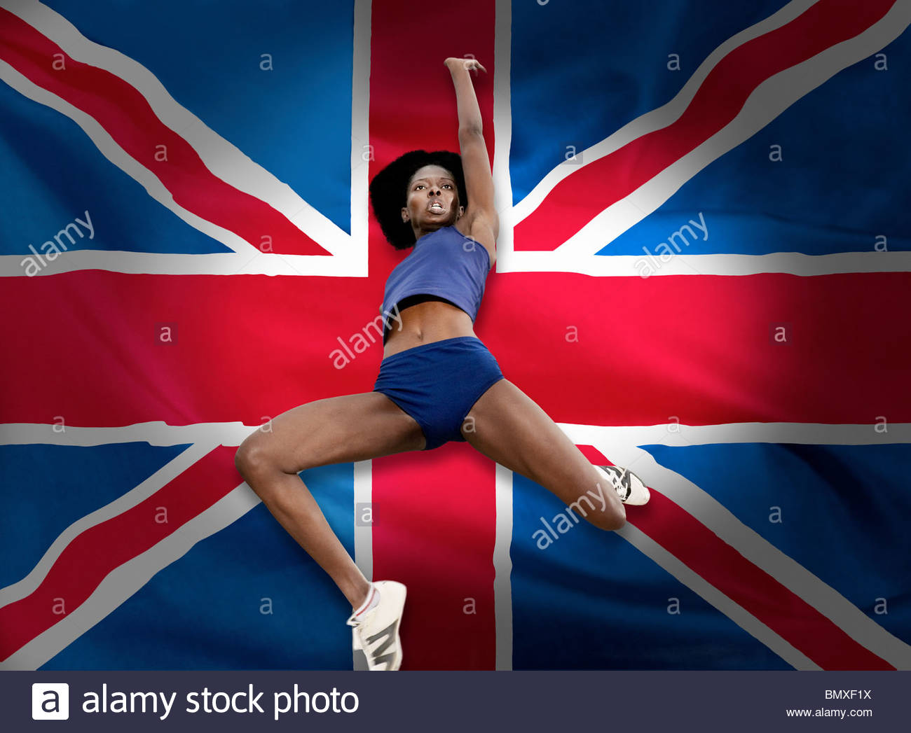 athlete jumping in front of british flag stock photo royalty free