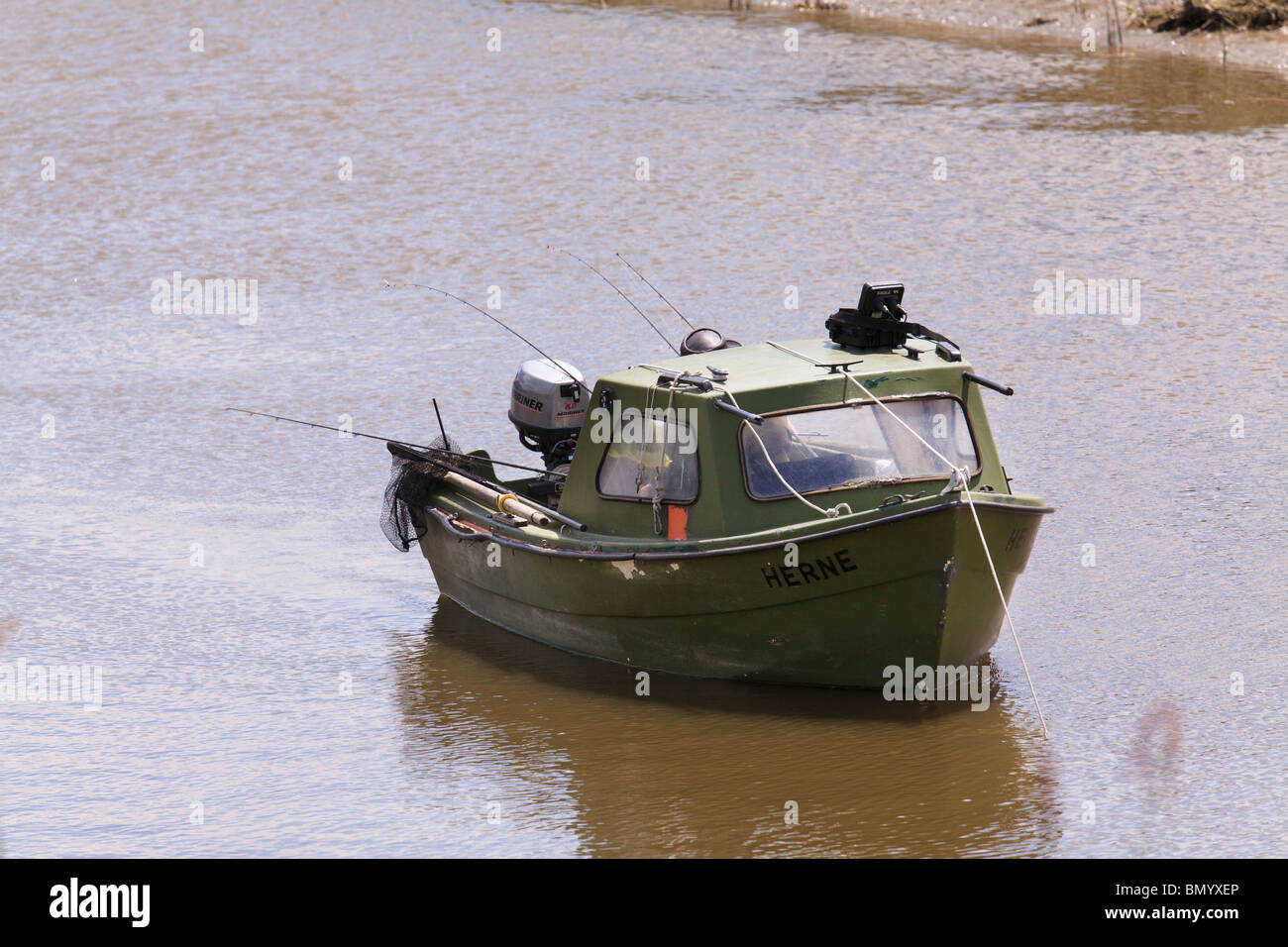 small motor fishing boat with one fisherman and many