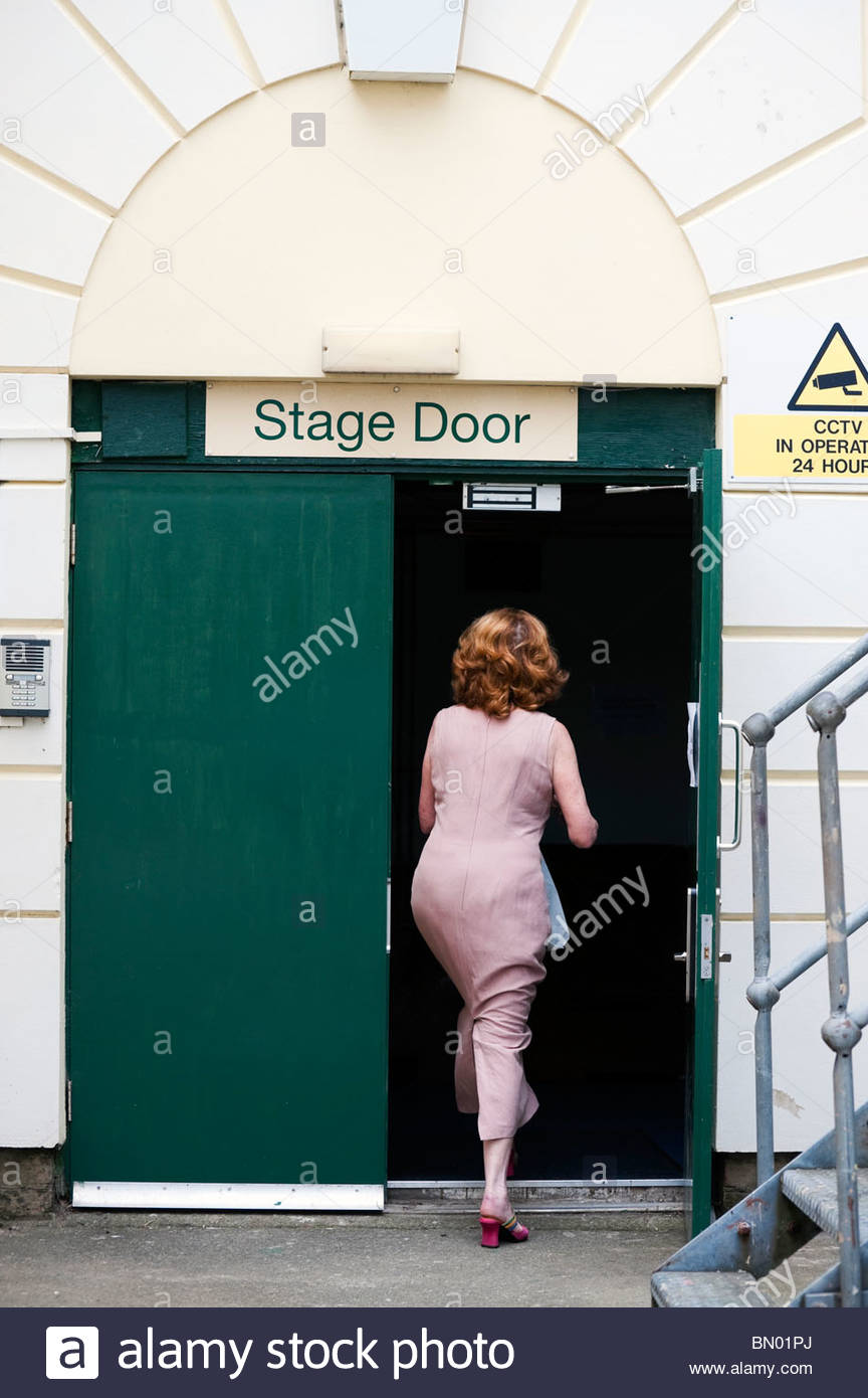 A woman walking through the stage door at the Dylan Thomas theatre in Swansea South Wales UK & A woman walking through the stage door at the Dylan Thomas theatre ... pezcame.com