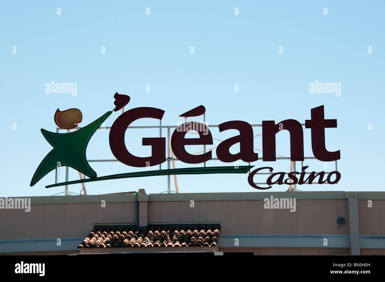 geant name on roof of casino supermarket outside beziers france stock photo royalty free image. Black Bedroom Furniture Sets. Home Design Ideas