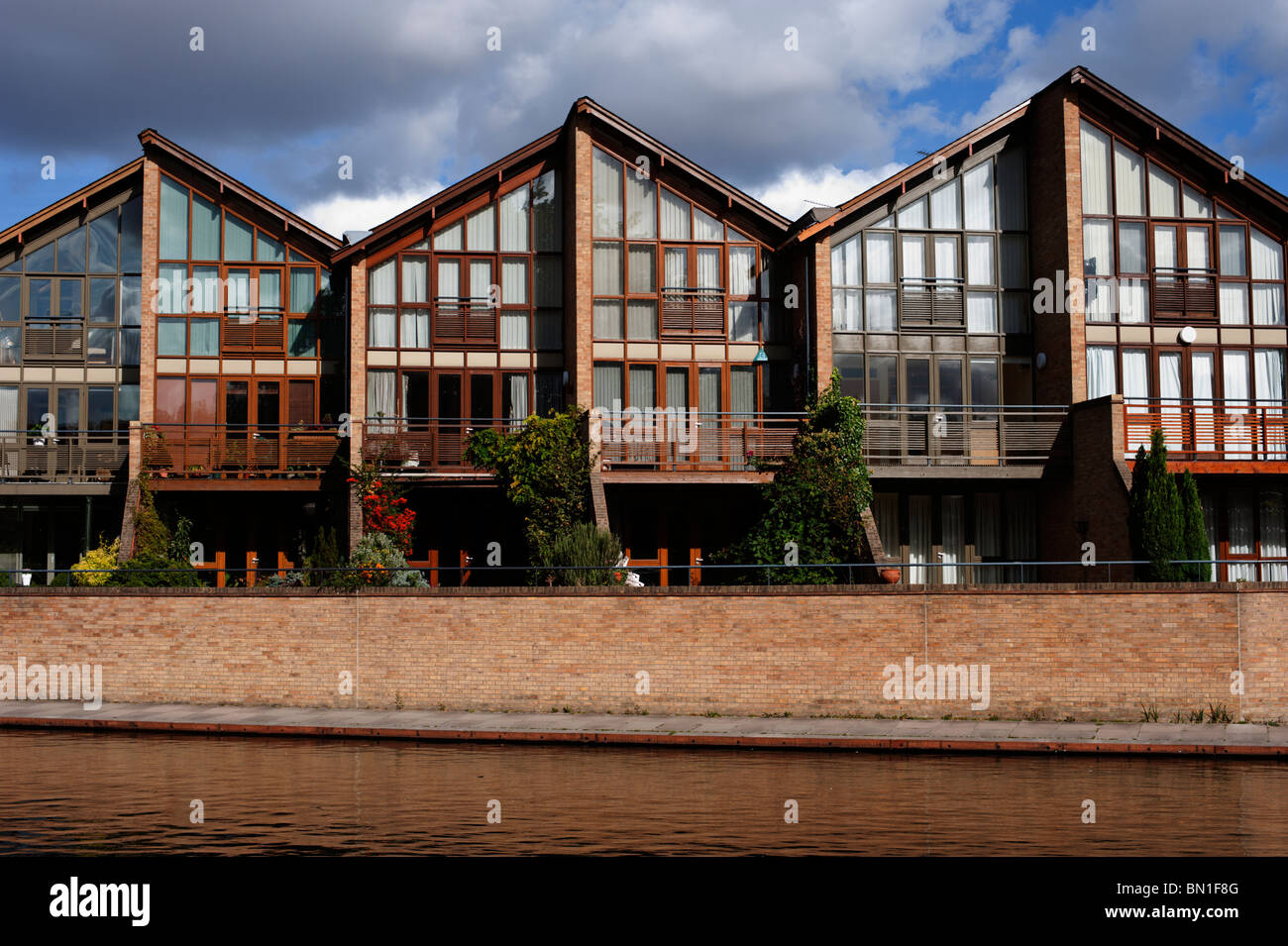 Glass Fronted Modern Houses Front Onto The River Cam In Cambridge
