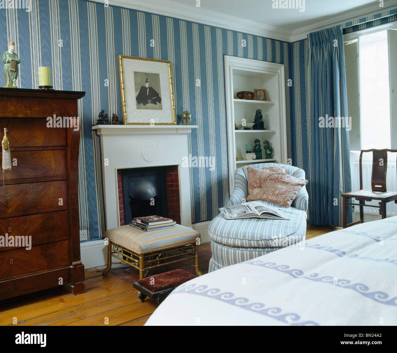 Blue Striped Wallpaper In Townhouse Bedroom With Striped Chaise Longue  Beside Fireplace