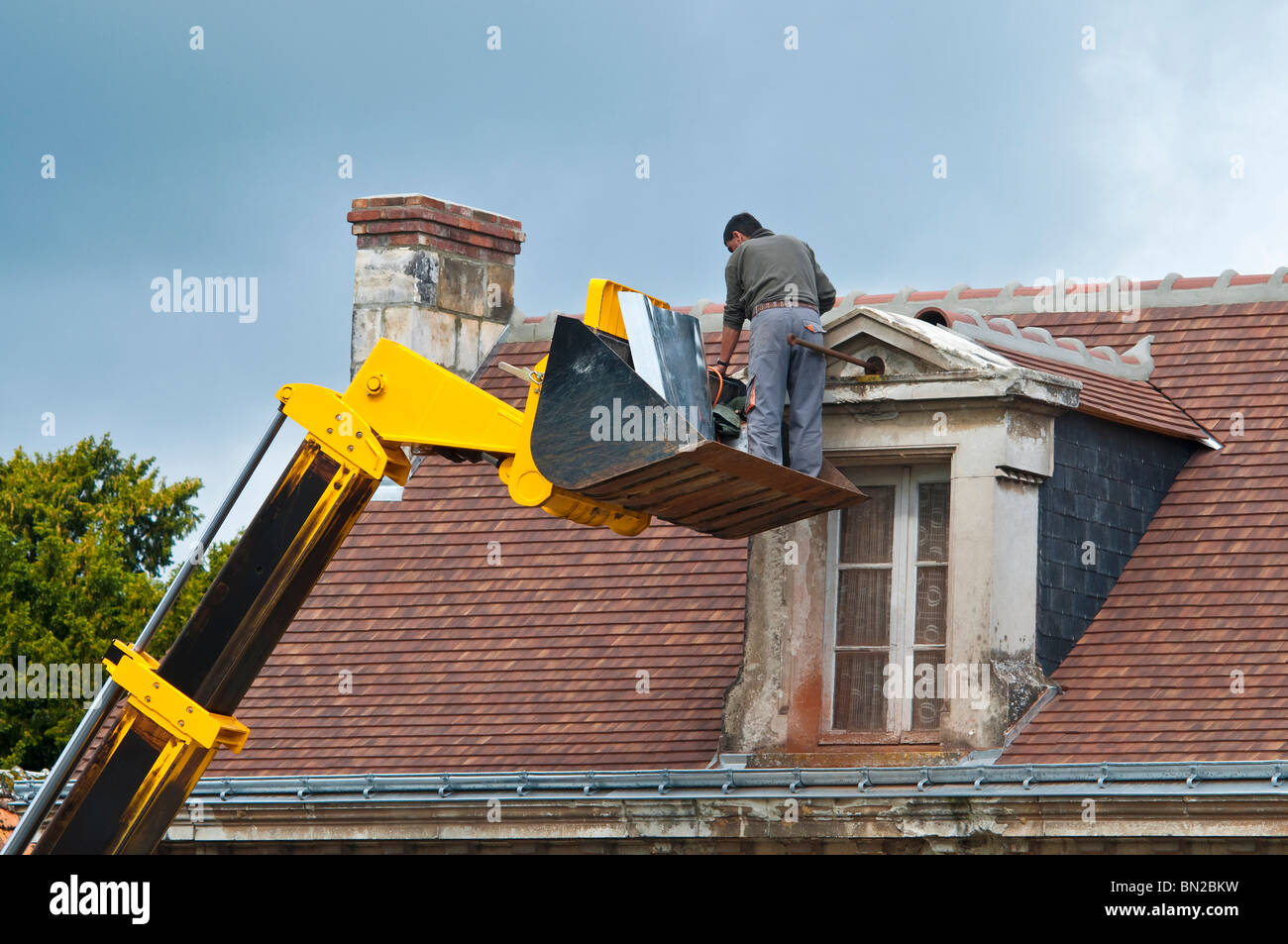 Contractor Repairing Attic Dormer Roof / No Safety Equipment Or Helmet    France.