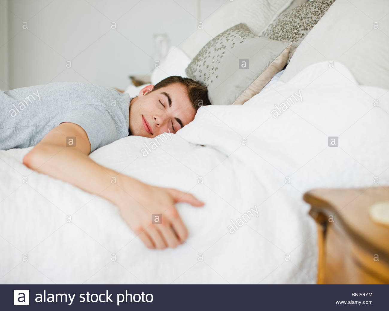 happy man laying on bed stock photo, royalty free image: 30175368