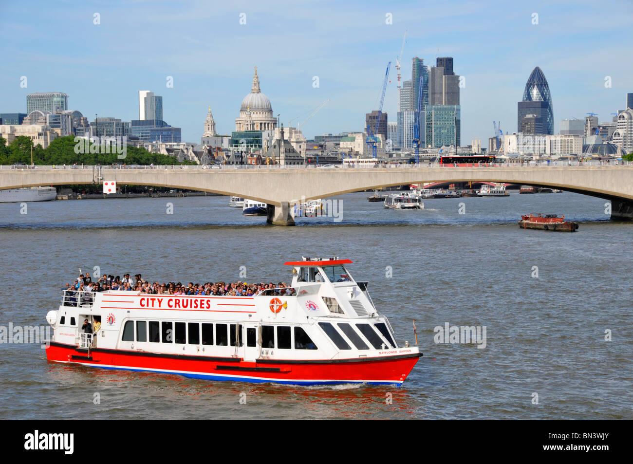 River Thames tour boat Waterloo Bridge and City of London