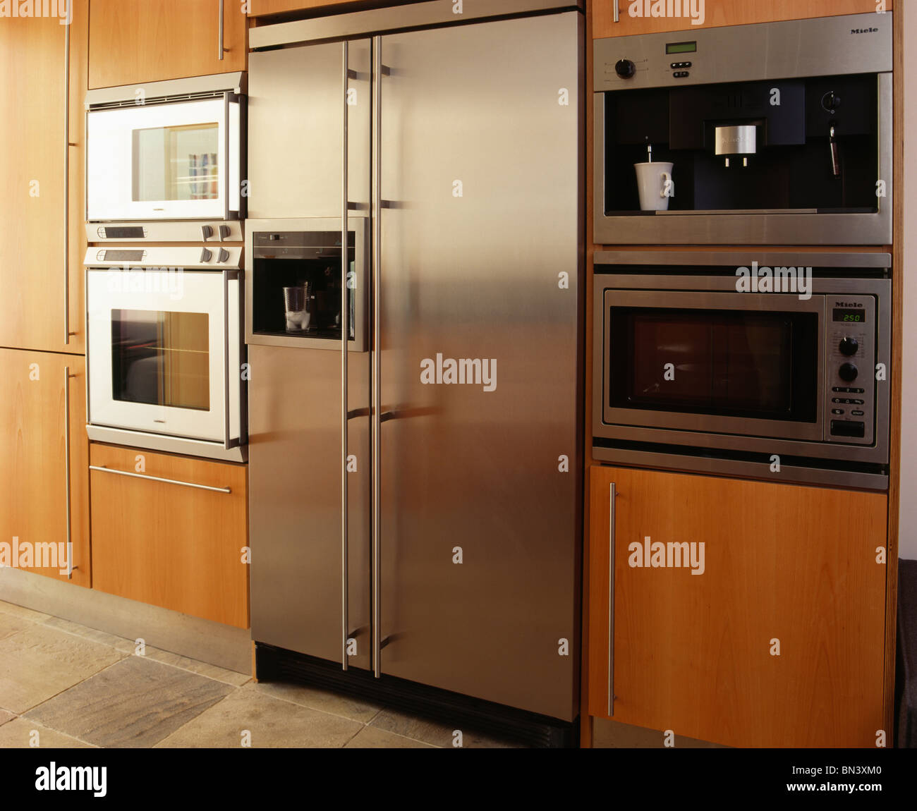 Large Fridges And Freezers Part - 30: Large Stainless Steel American Style Fridge-freezer And Wall-mounted Double  Oven And Coffee Machine In Modern Kitchen