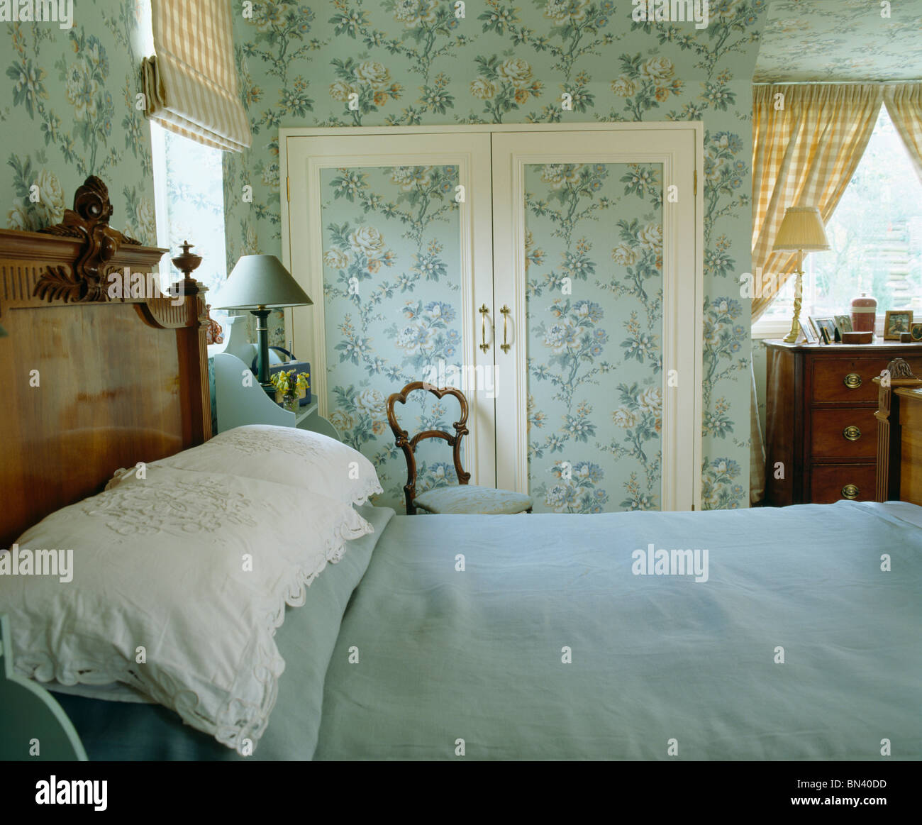 blue bed cover and white pillows on bed in country bedroom with