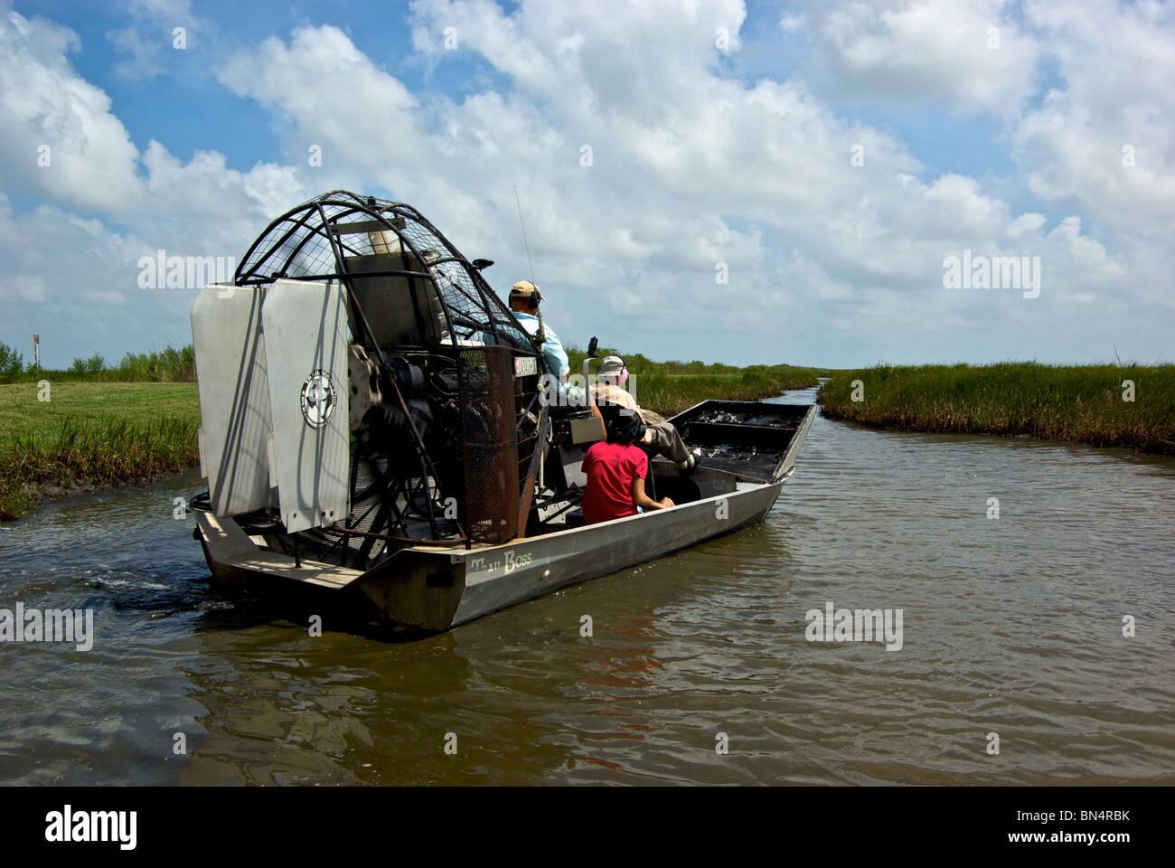 Visitors Taking Tour Of Louisiana Bayou In Big Fan Motor