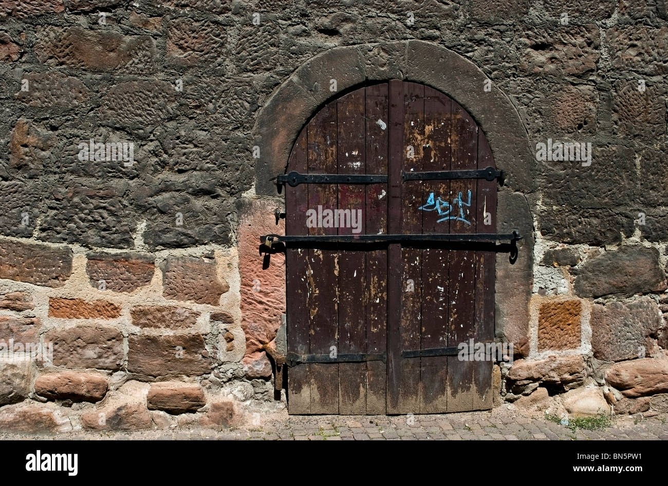 A Wooden Door Of A Cellar Of A Medieval House In Marburg