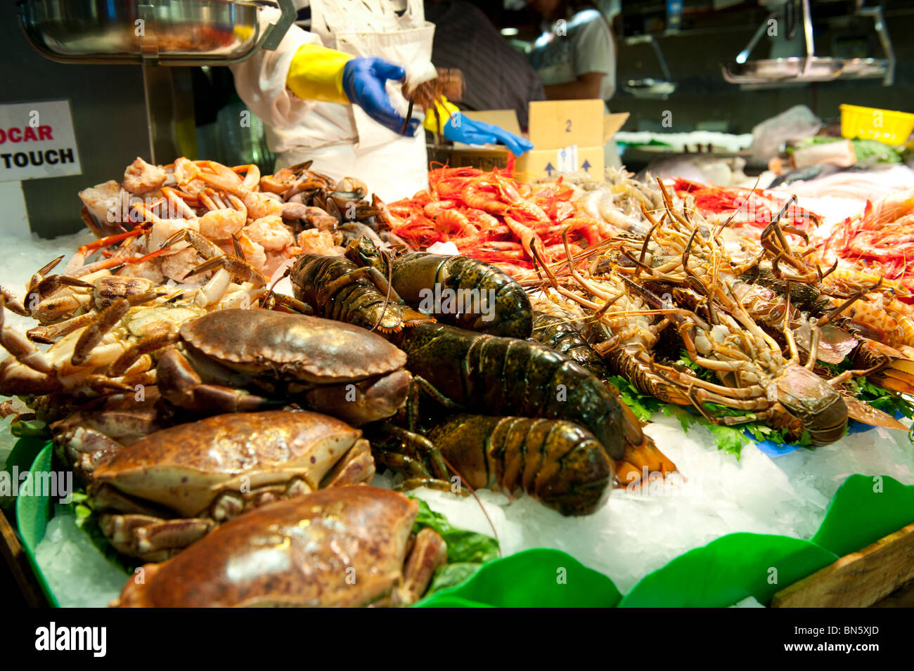 Fresh fish and seafood shop at the market of la boqueria for La fish market