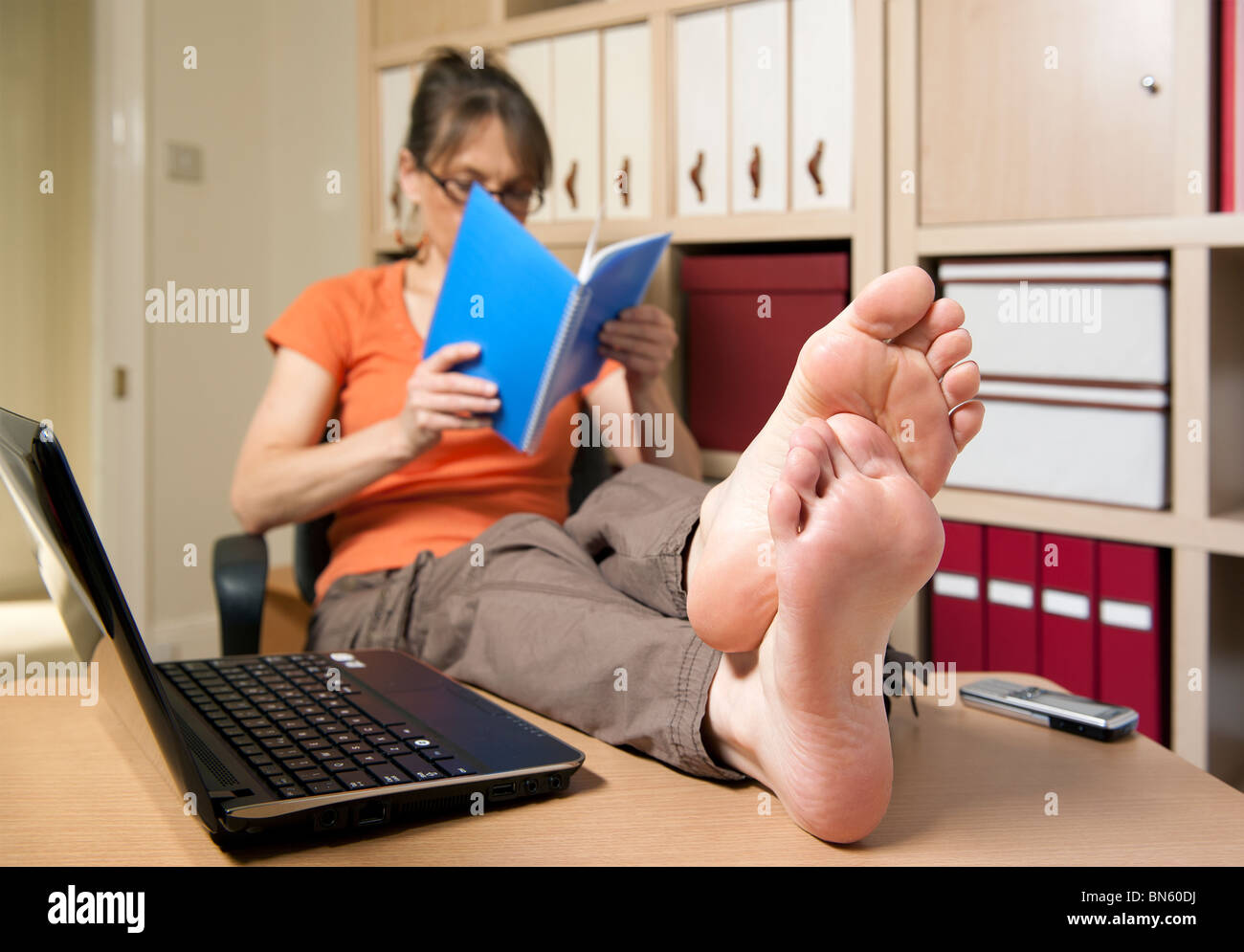 Bare feet on desk