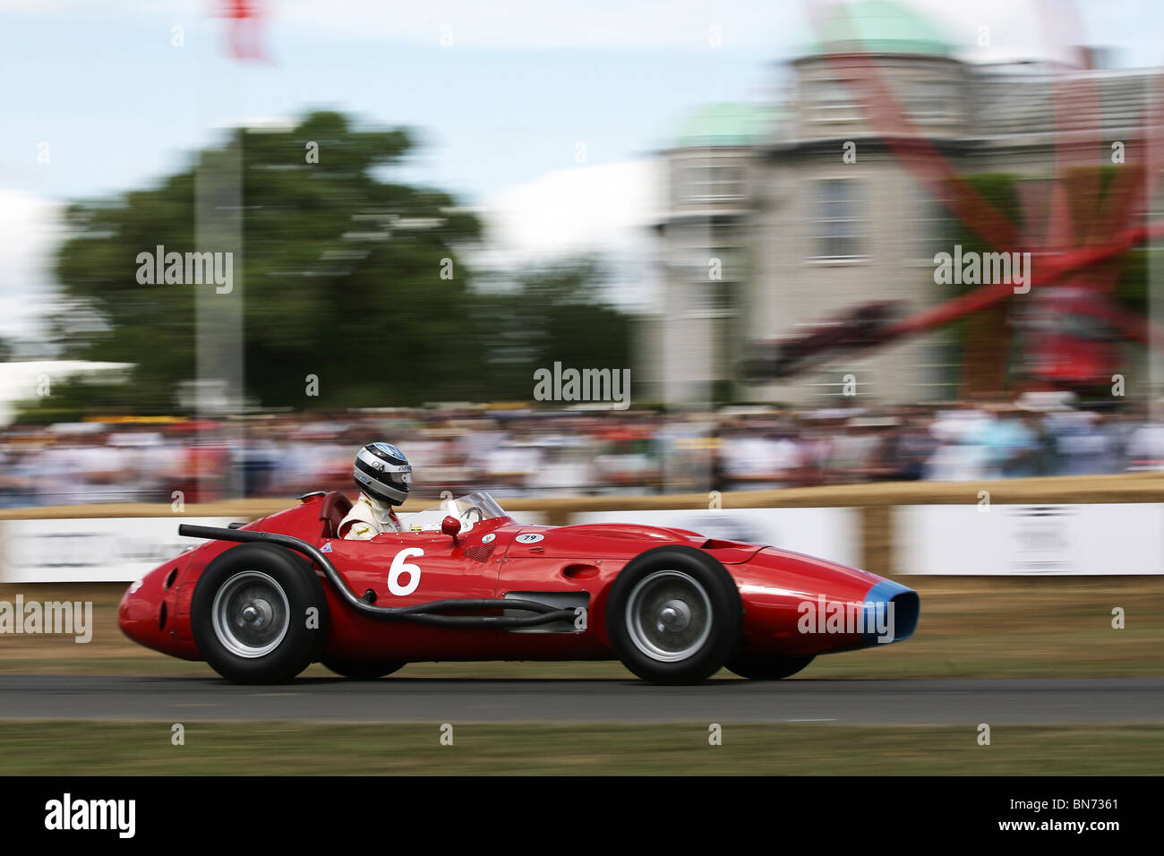 an historic maserati grand prix car powers past goodwood house at the stock photo royalty free. Black Bedroom Furniture Sets. Home Design Ideas
