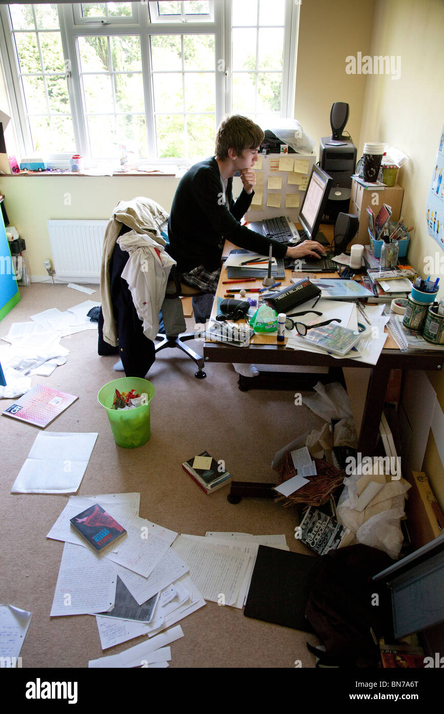 teenager studying at a computer in a messy bedroom stock photo  teenager studying at a computer in a messy bedroom
