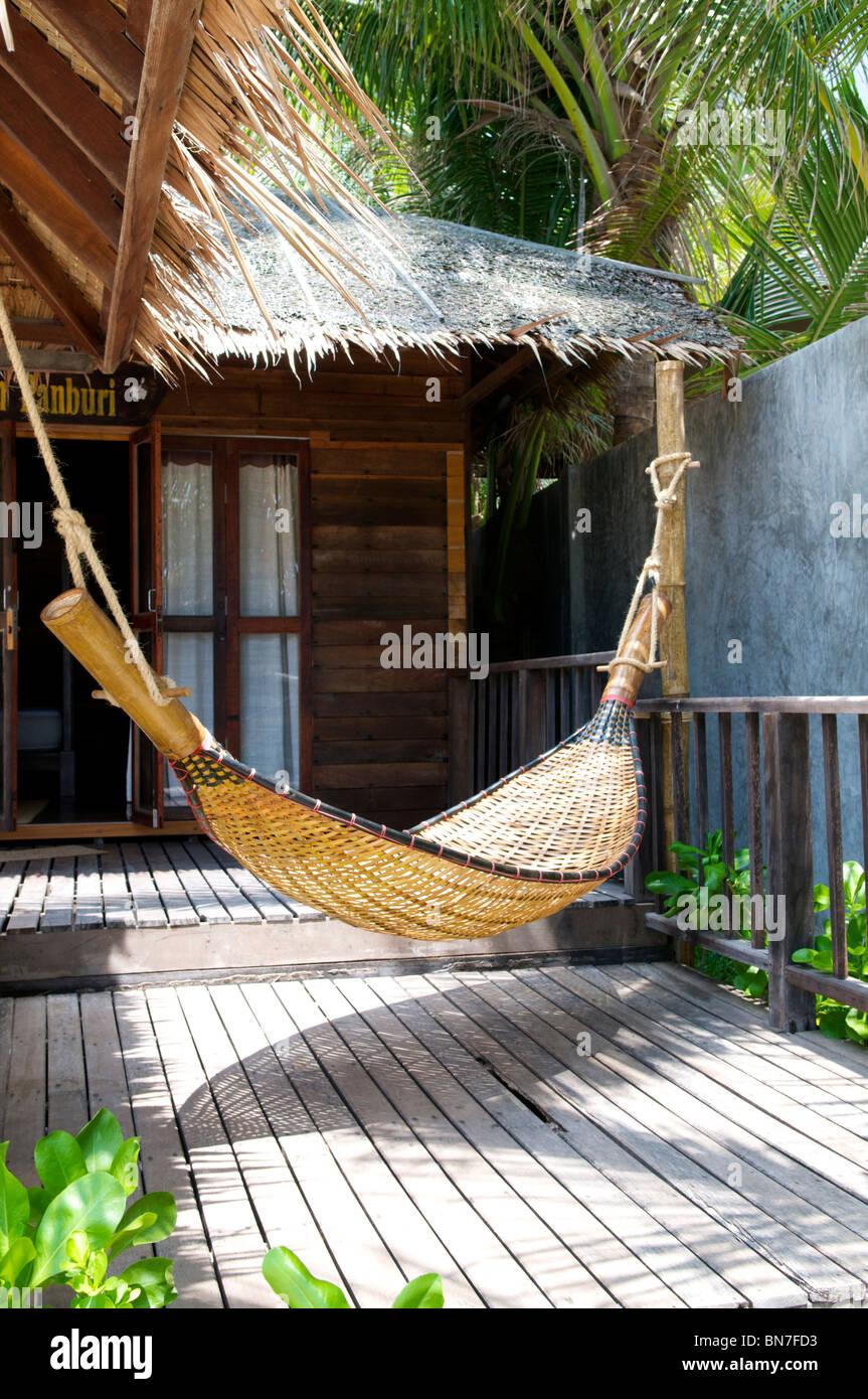 bamboo hammock on a beach bungalow deck bamboo hammock on a beach bungalow deck stock photo  30283935   alamy  rh   alamy