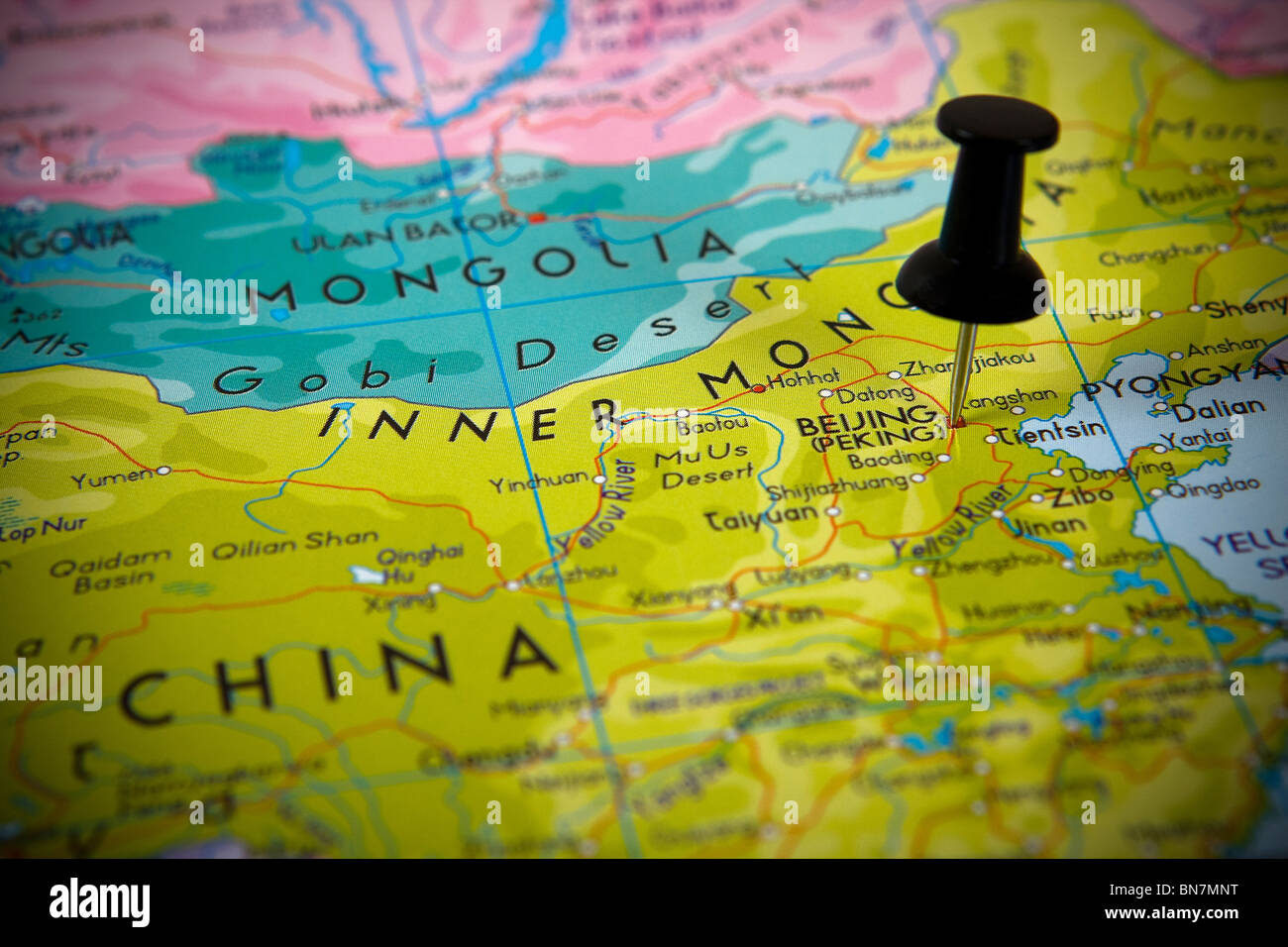 small pin pointing on beijing china in a map asia