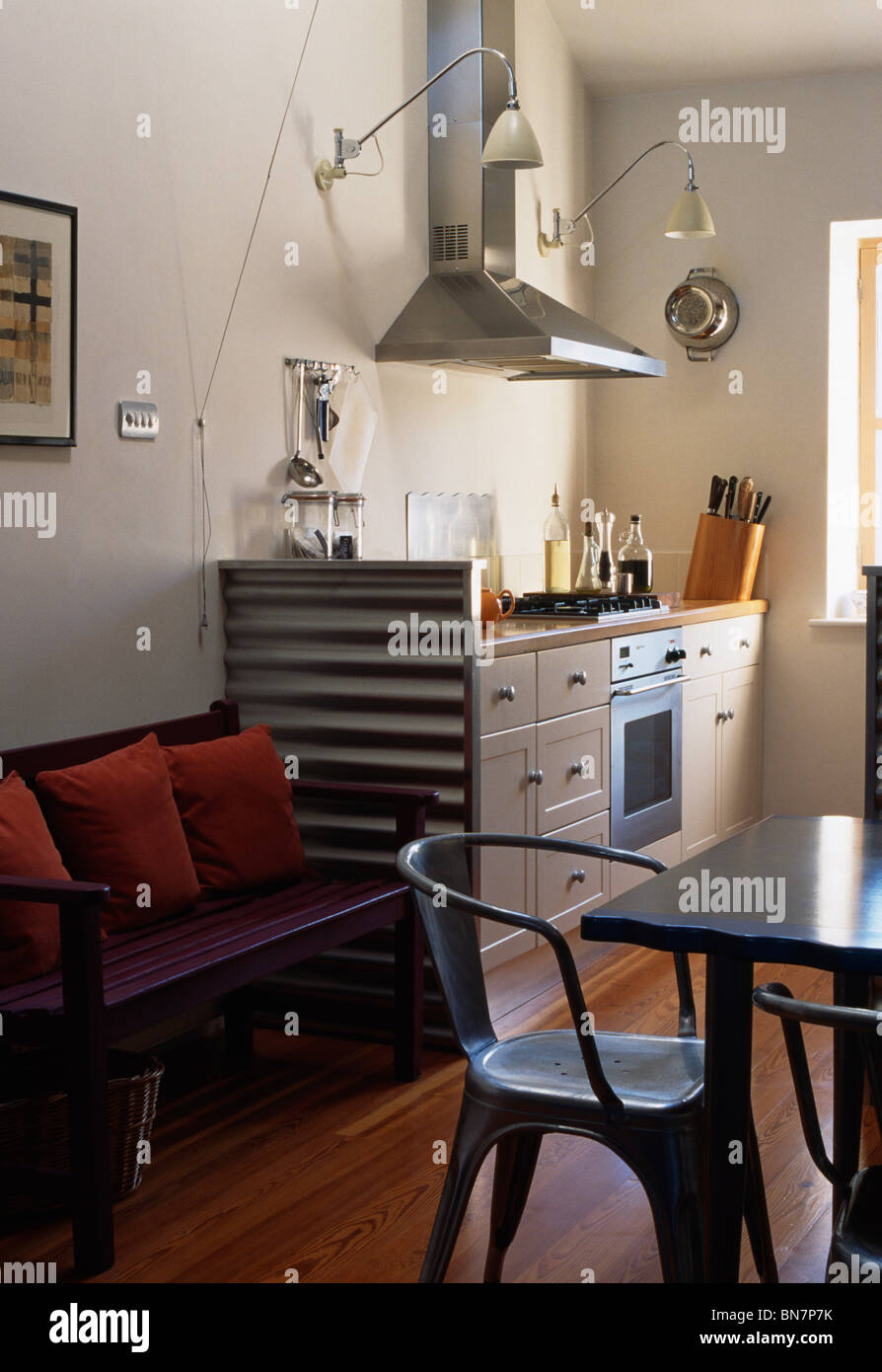 Metal Chairs At Table In Modern Kitchen Dining Room With Wooden Settle Beside Unit