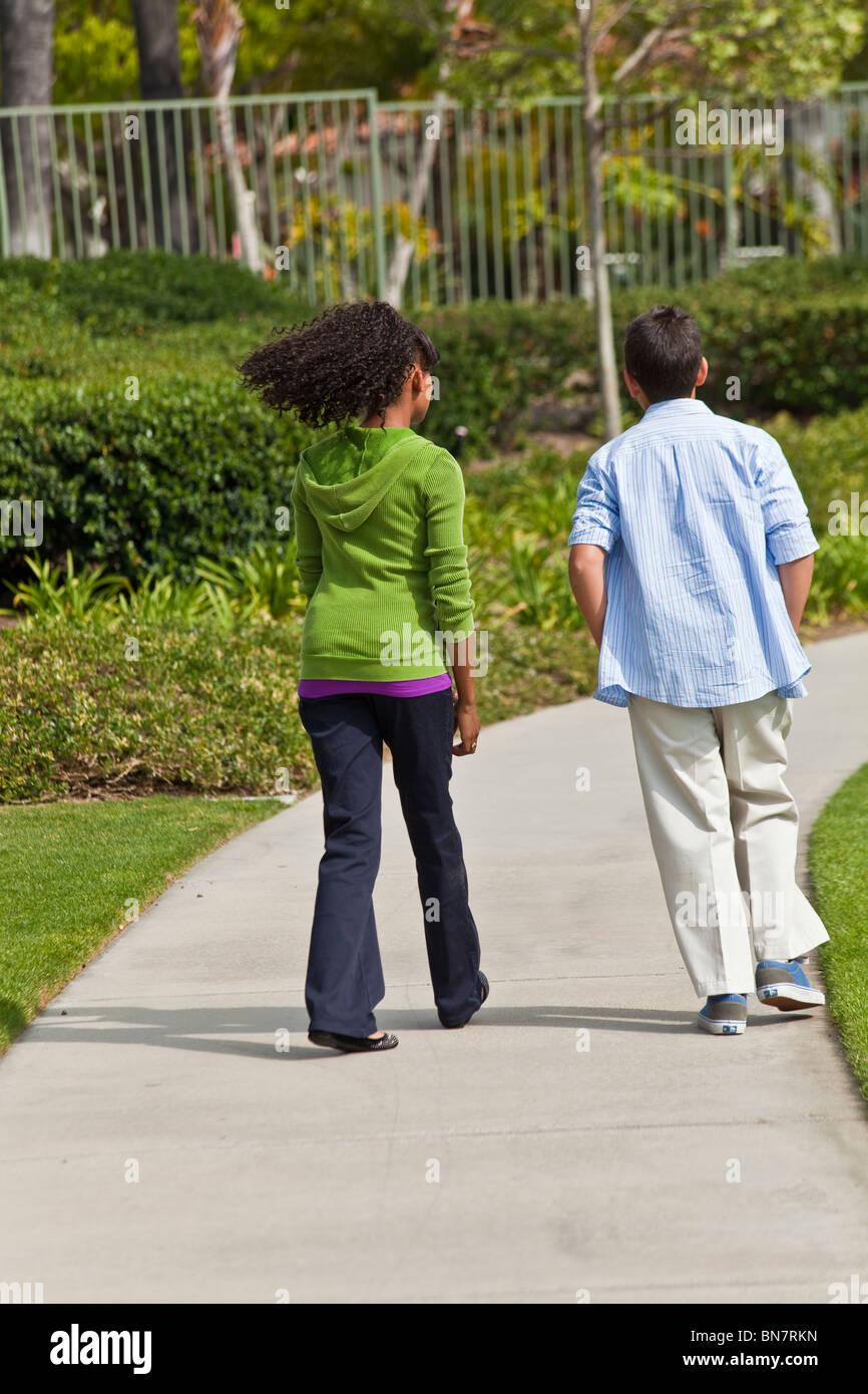 A Boy Walking Away From A Girl     boy walking away  MR Stock
