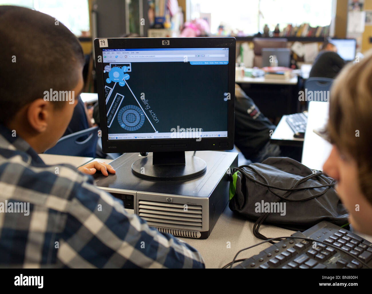High school boys work together on computer aided design during freshman engineering class stock